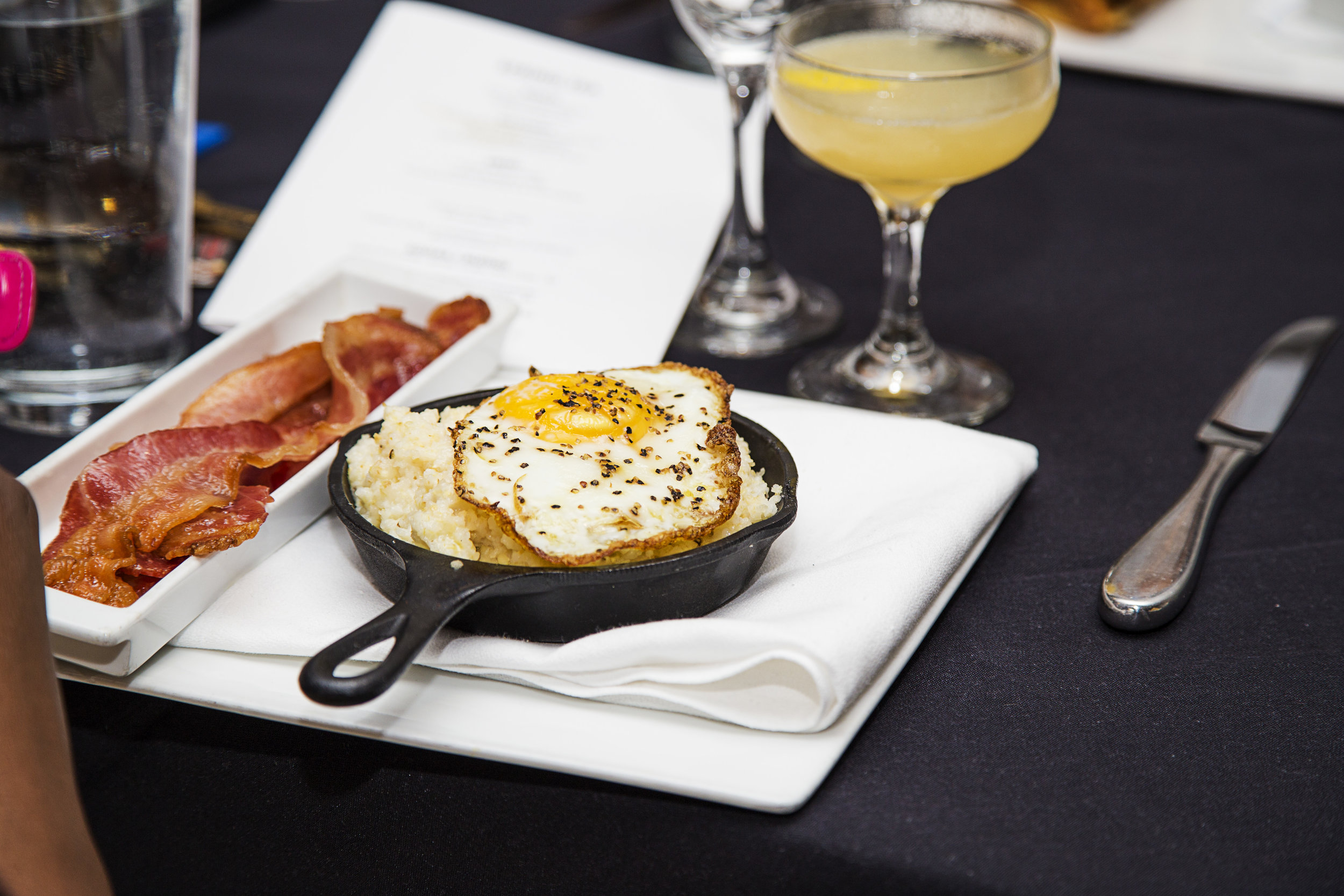 Salon Grits with a Sunny Side Egg and Bacon - Sucre.jpg