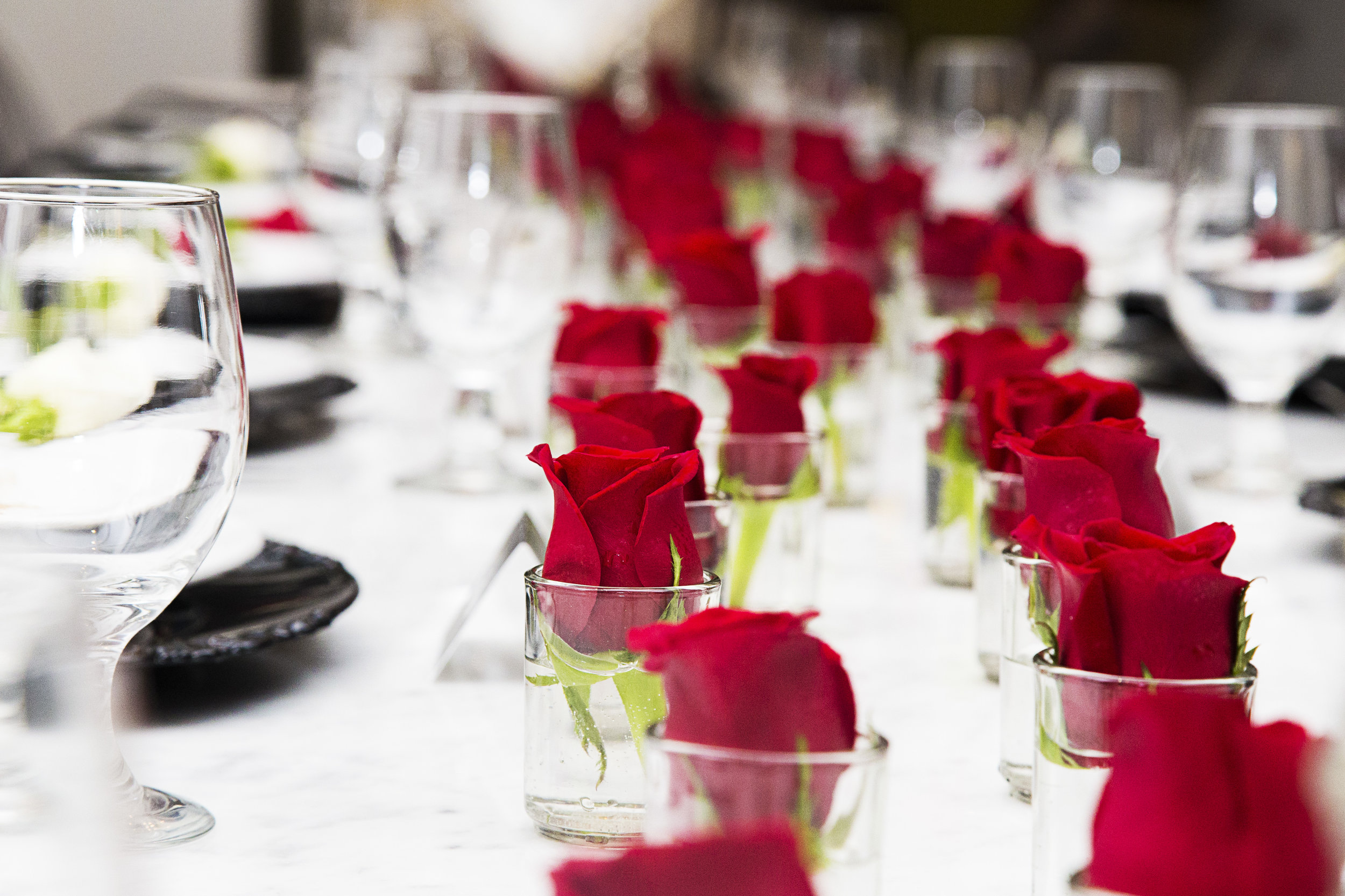 saints vs sinners dinner table flowers.jpg