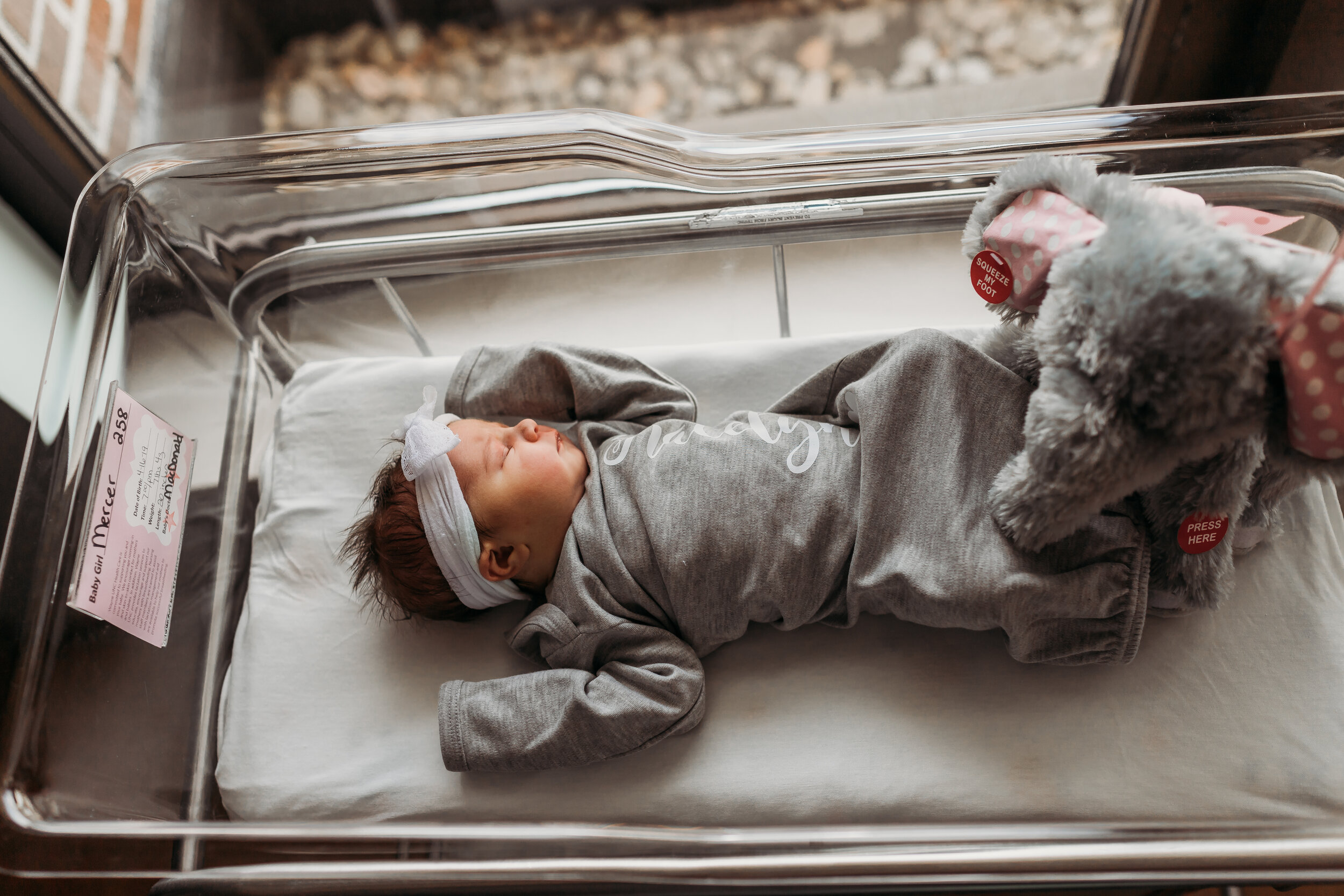 baby in personalized outfit with gift from family