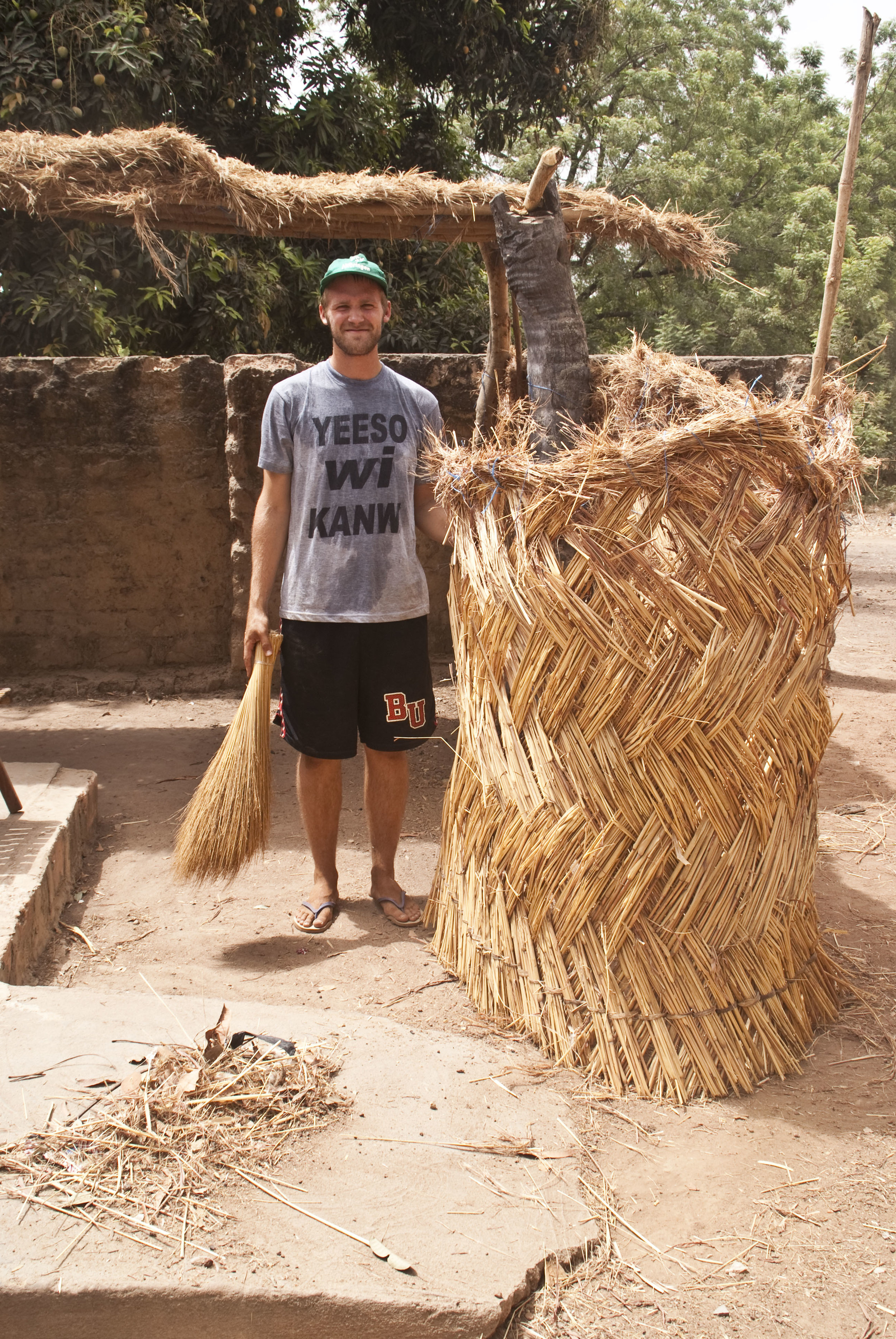 Me sweeping my courtyard during my Peace Corps service in Burkina Faso.