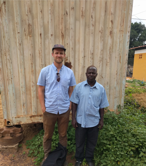 Me with my N'ko instructor, host and friend in Guinea during fieldwork for my dissertation.