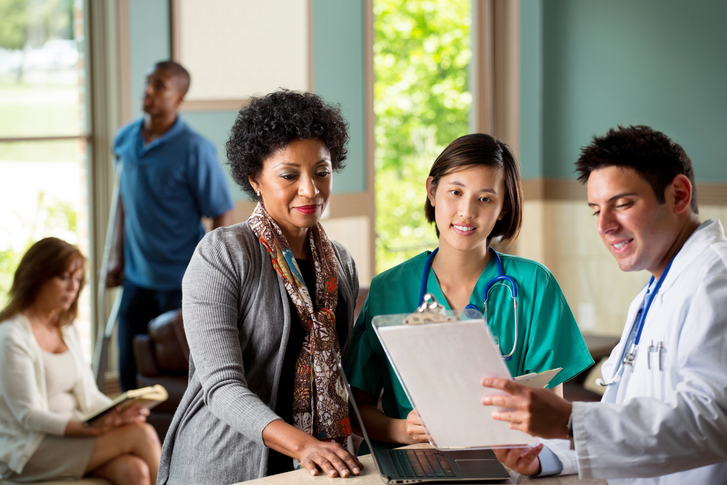 Canva - Medical Team Talking with Patients.jpg
