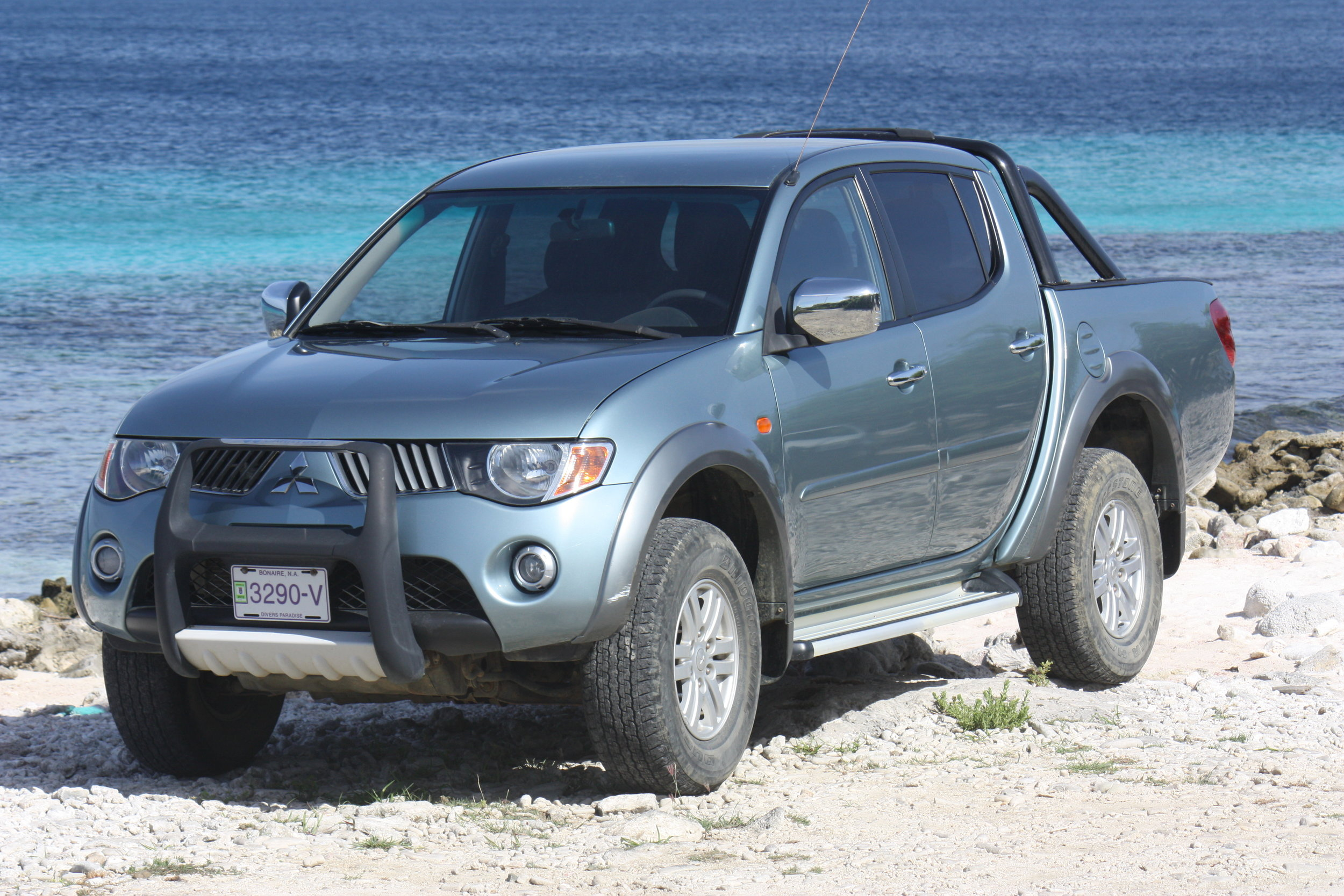CAR   The island worthy pick-up seats 5 adults and comes with large cargo area, ideal for divers.