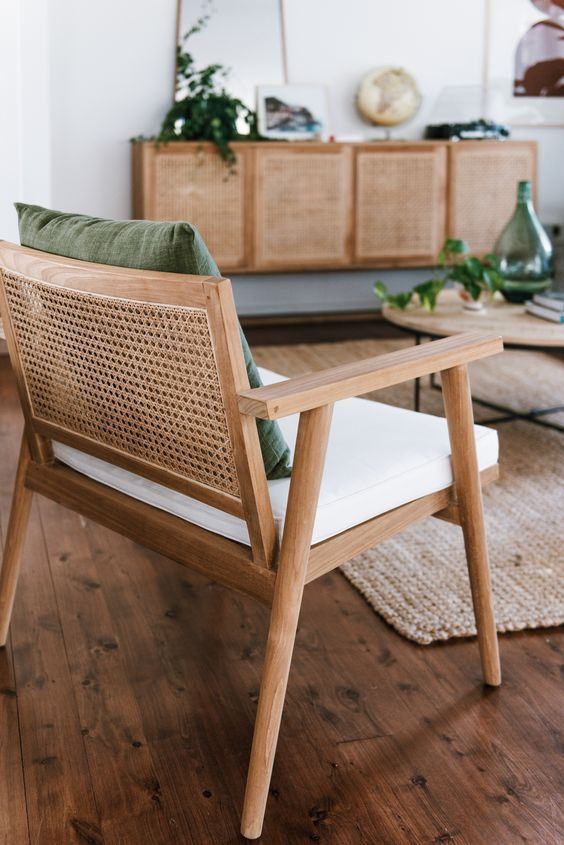 Woven rattan chair and light oak coffee tables