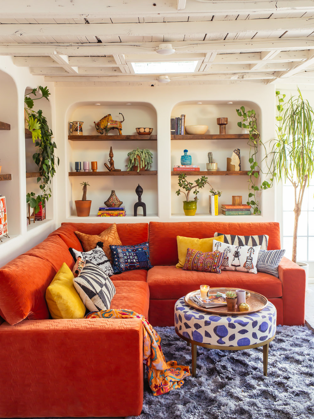 Sofa with a pop of color in a tropical living room