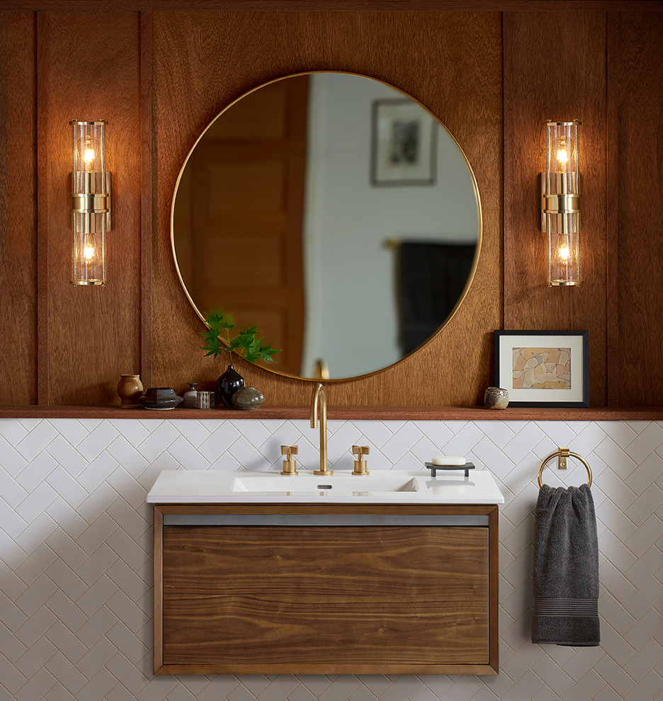 Aged brass perfectly ties in with this contemporary bathroom's faucet and accessories.