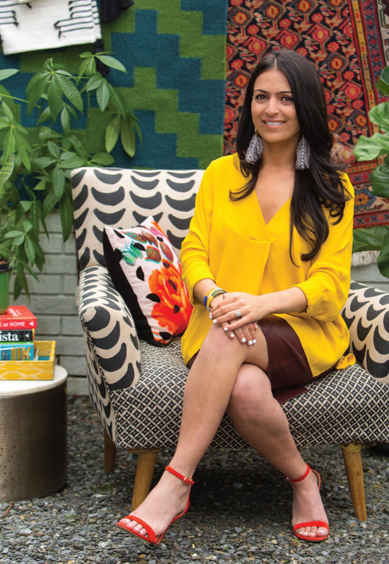 Verena Dalati Salmé from Yellow Bungalow Interior Design Studio sitting on a Anthropologie chair