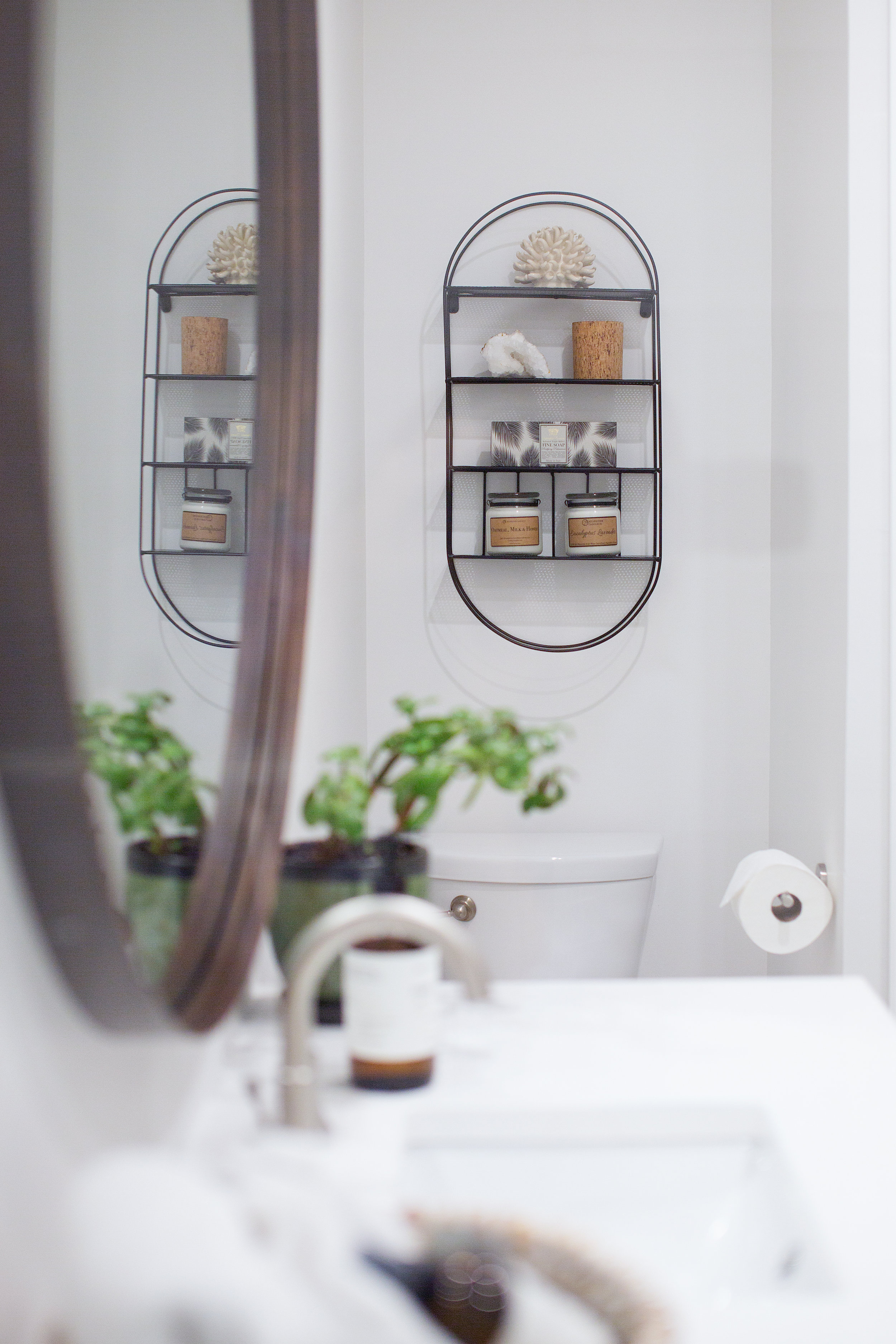 Metal shelving above toilet in guest bathroom