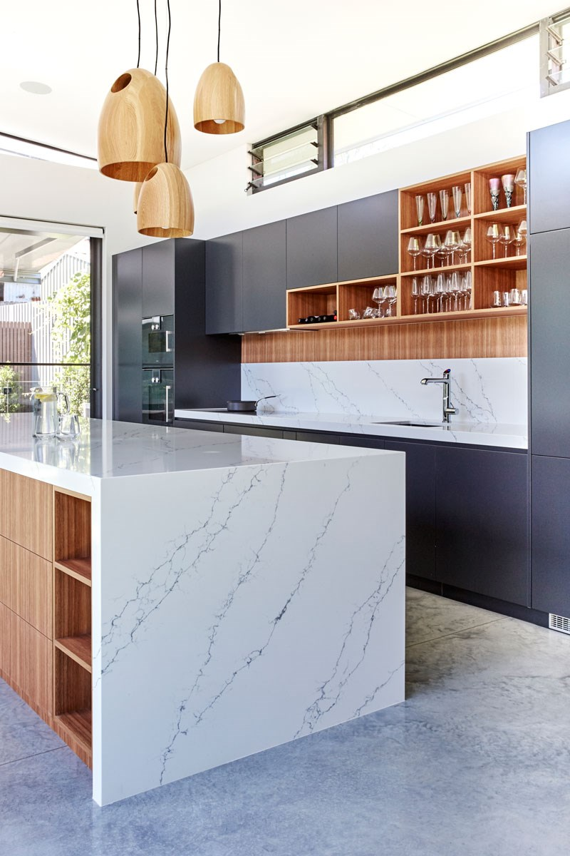 Quartz is a non-porous man-made material that can mimic the look and feel of granite or marble.
