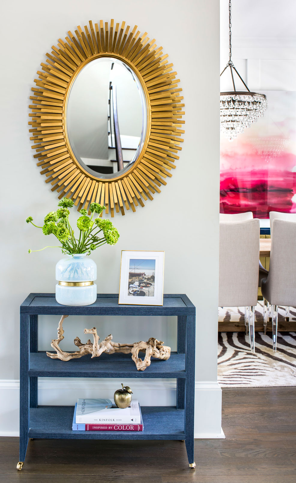 Entryway with gold mirror and navy accent table