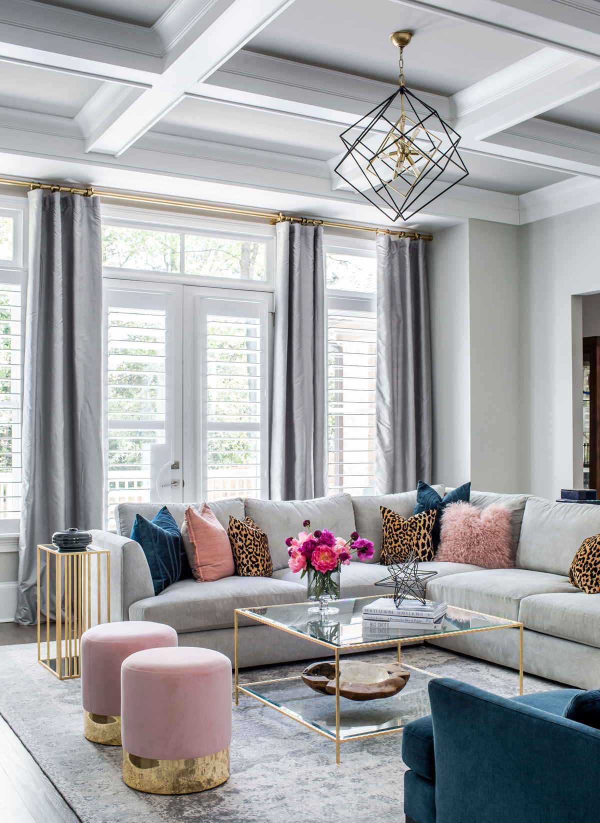 Family room with velvet furniture and brass accents