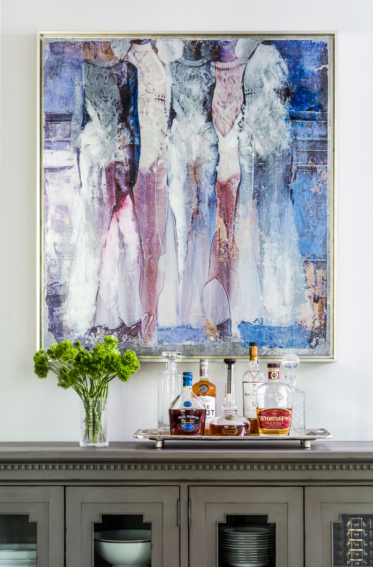 Blue and purple abstract art over an antique sideboard