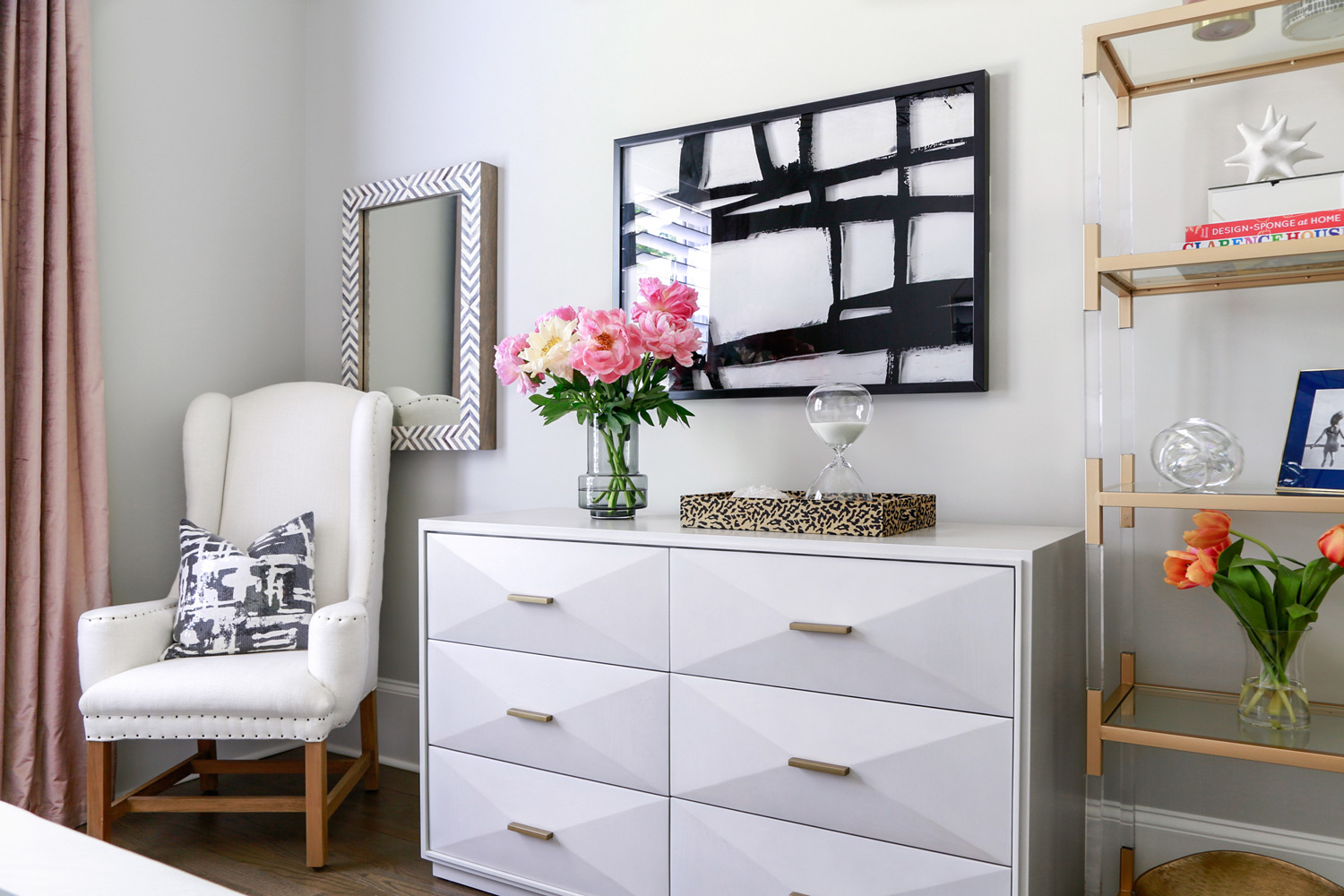 Contemporary guest bedroom with white dresser and glass shelves