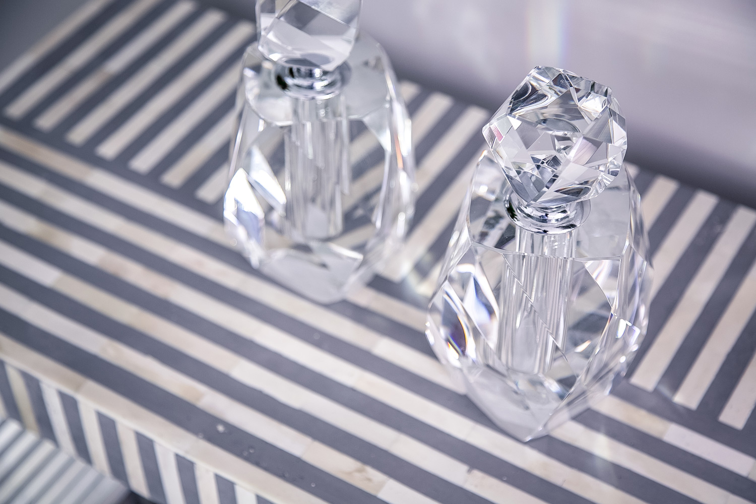 Striped bone inlay table with crystal decanters