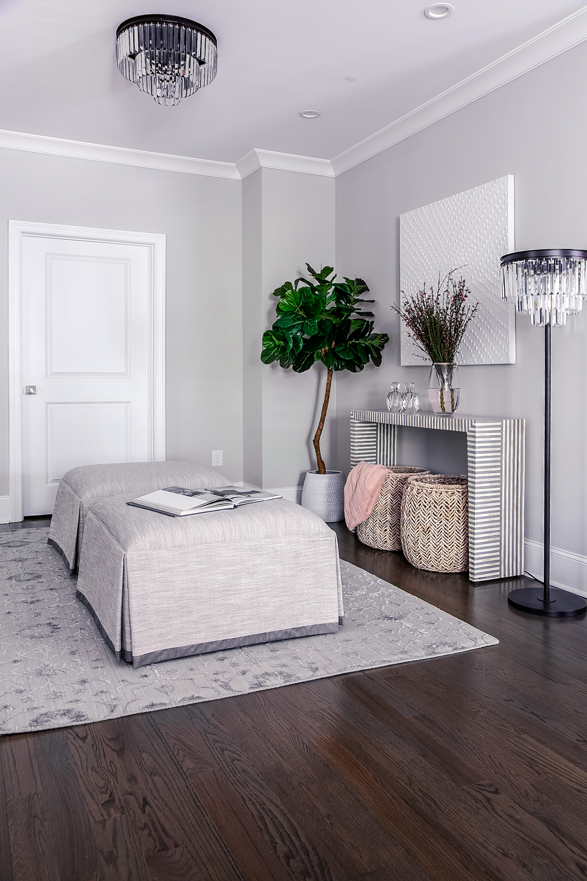 Elegant sitting area in master suite with grey ottomans