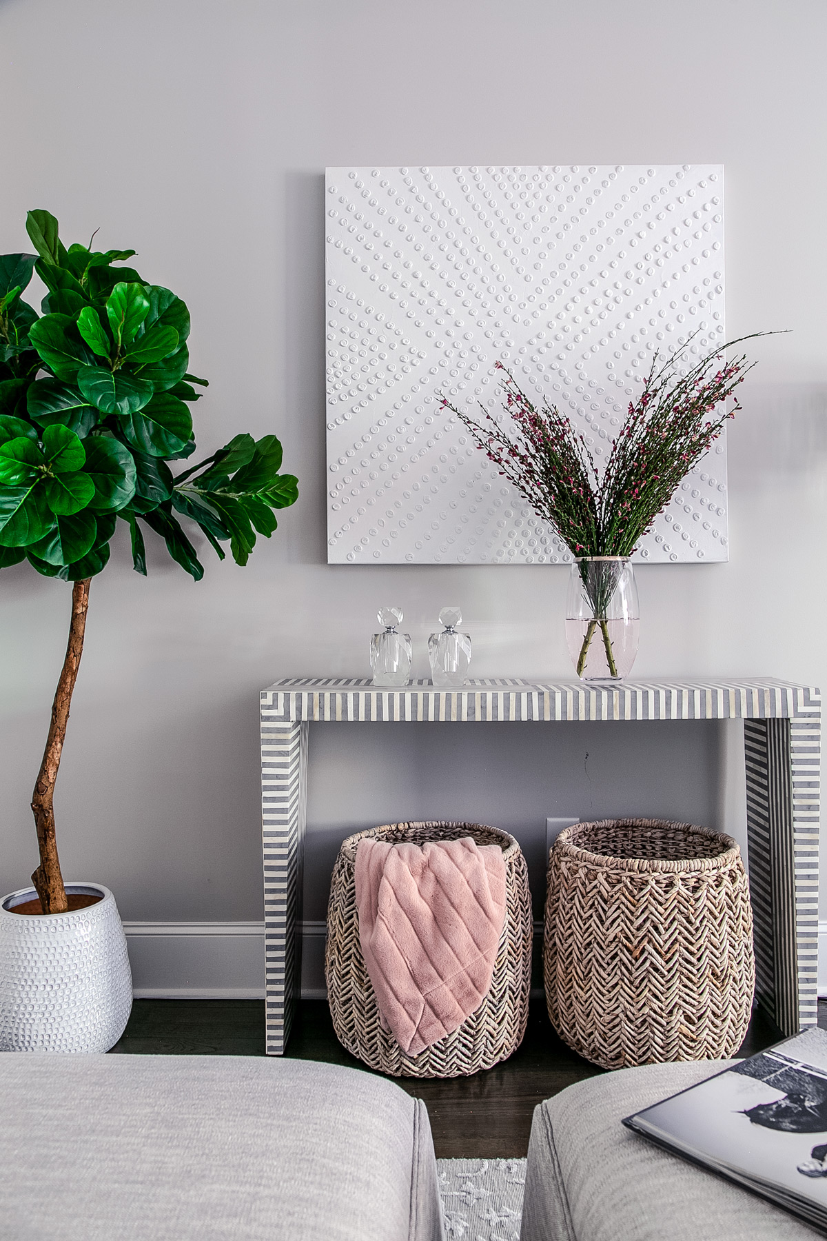 Wicker baskets and plants in master bedroom