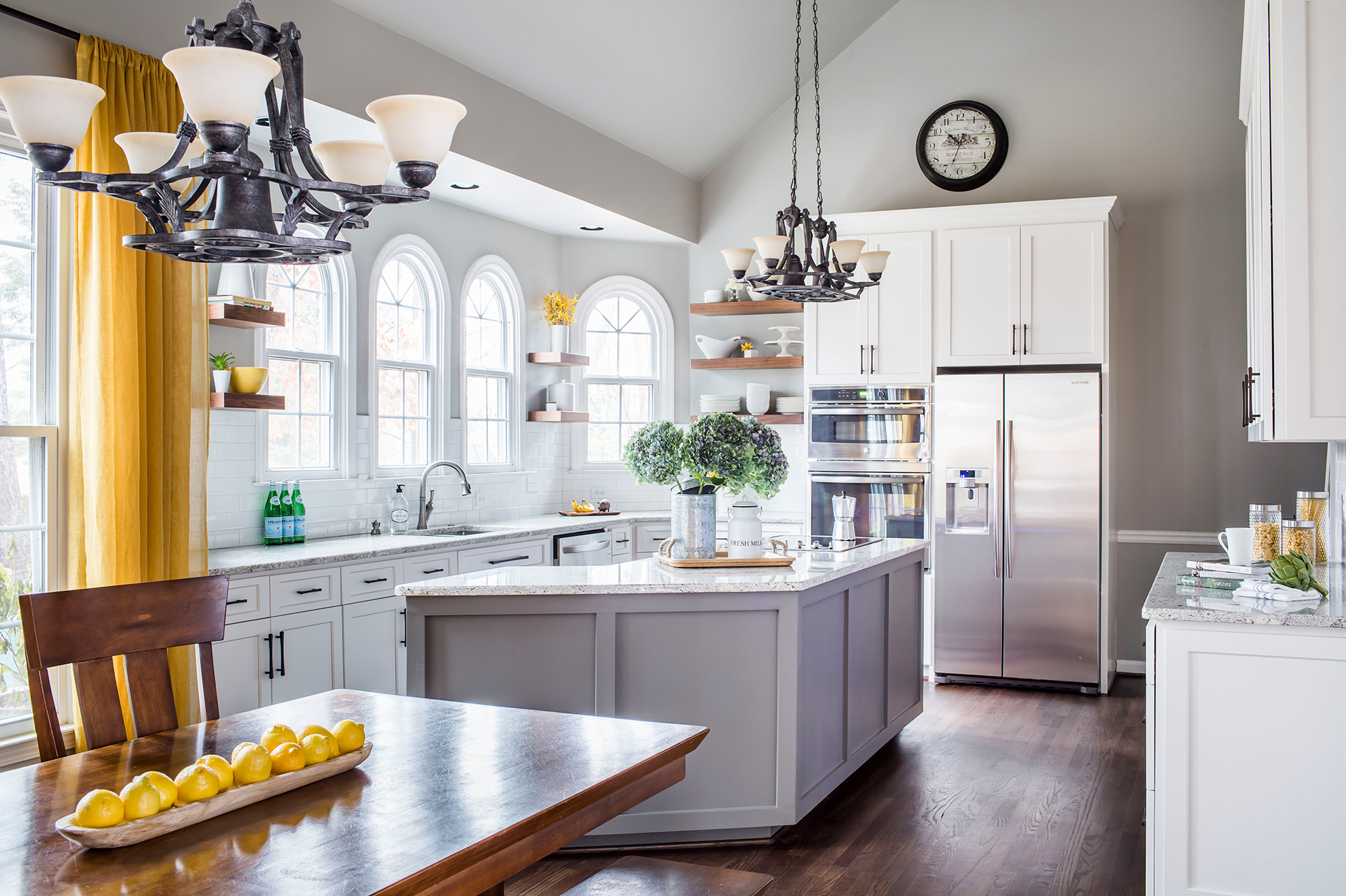 Transitional grey and yellow kitchen with stainless steel appliances