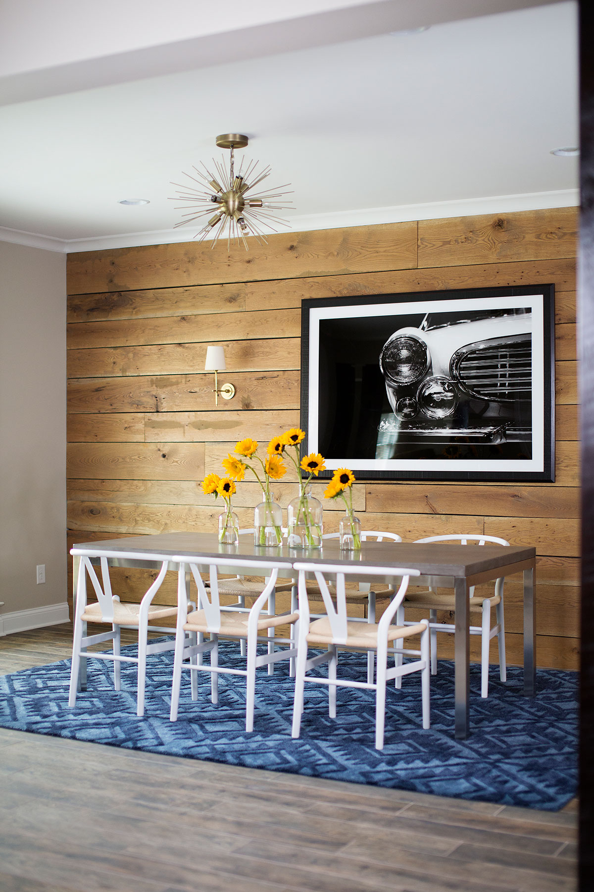 Wood paneled basement dining area with metal table