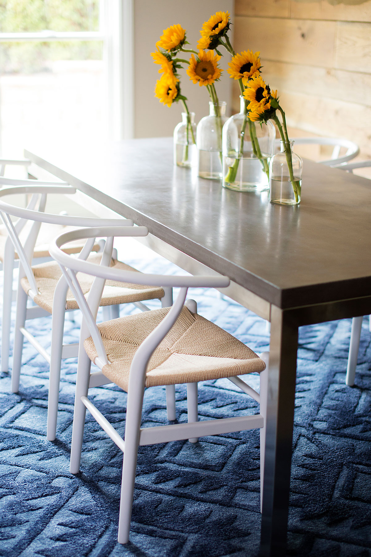 Metal dining table and Scandinavian dining chairs in basement