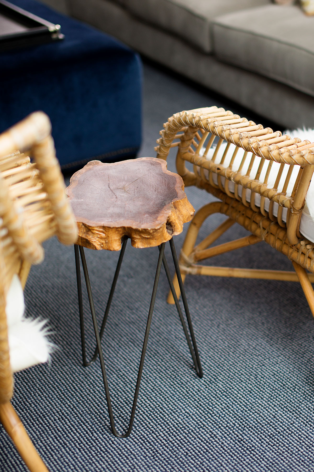 Rattan chairs and wood side table with hairpin legs