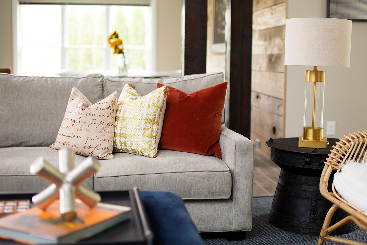 Casual basement with grey sofa and brass table lamp