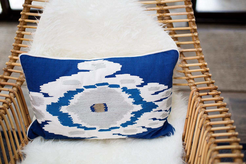 Rattan chair with Mongolian sheep skin and boho lumbar pillow