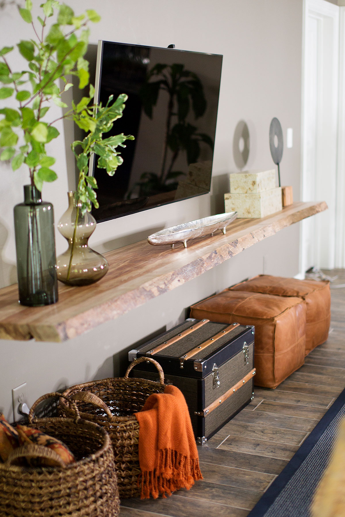 Reclaimed wood ledge with storage baskets underneath