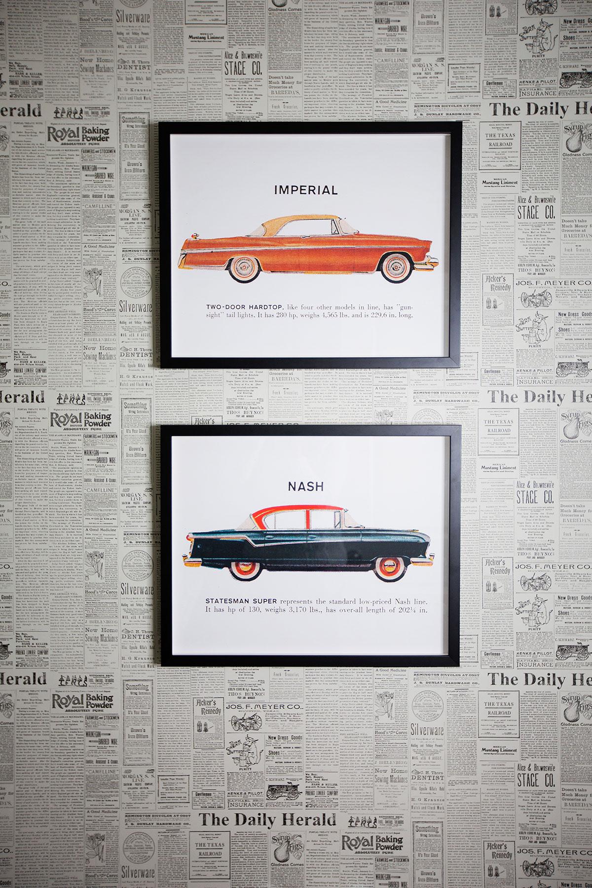 Powder room with newsprint wallpaper and car artwork