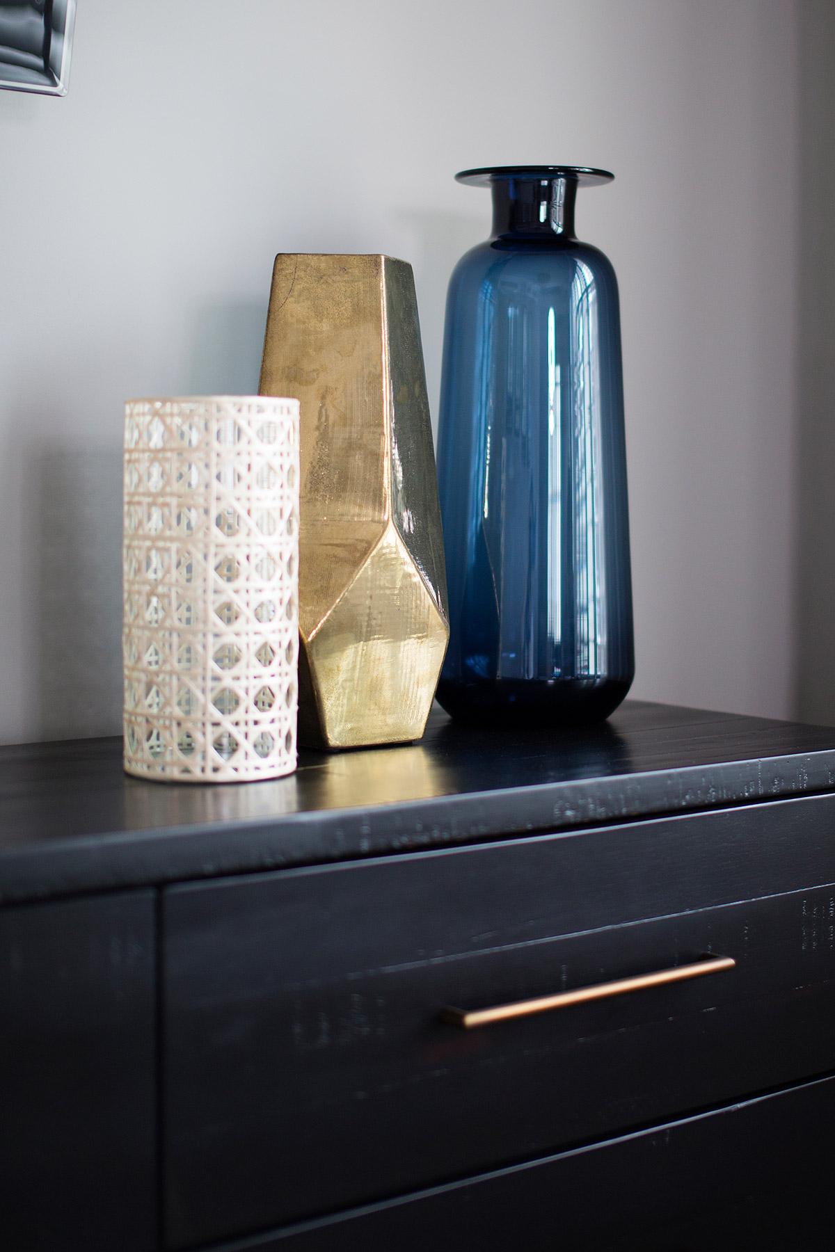 Three vases on top of espresso wood dresser