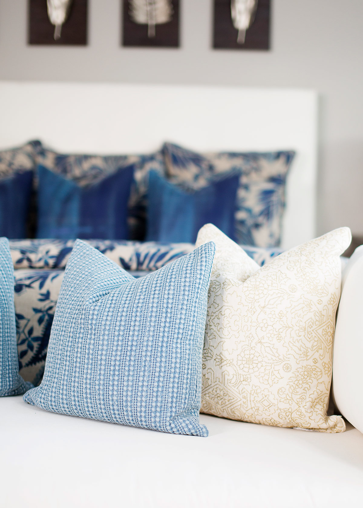 Throw pillows on chaise at foot of bed