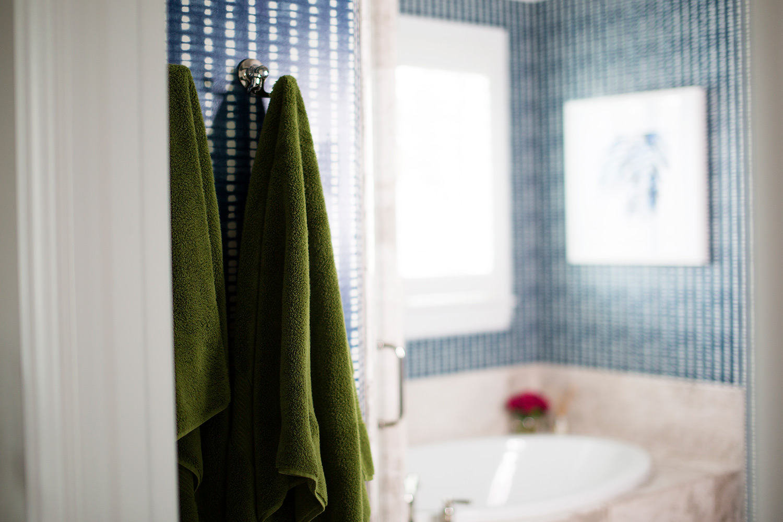 Polished nickel robe hook in transitional master bathroom