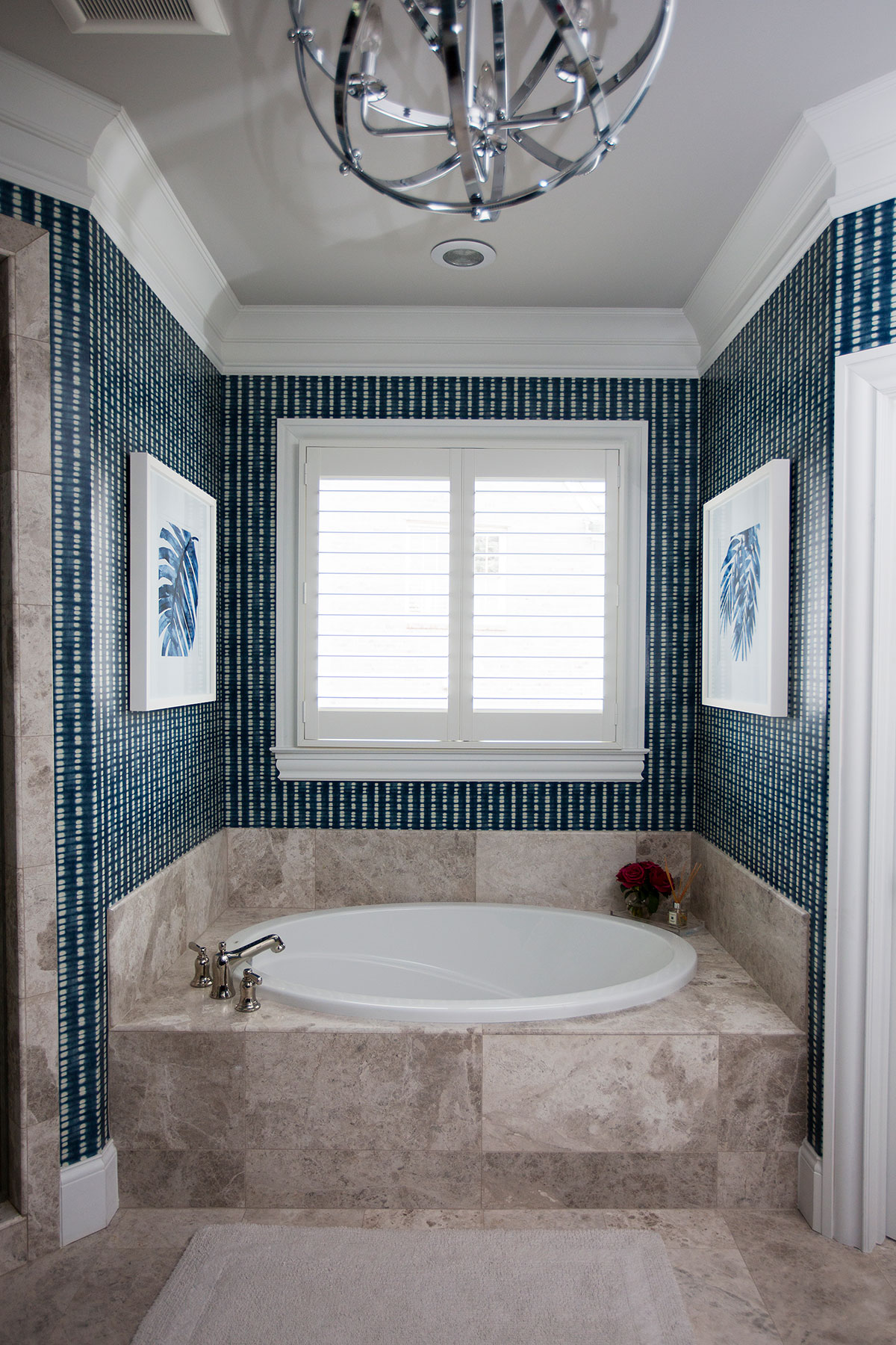 Built in tub in transitional master bathroom with blue and white wallpaper