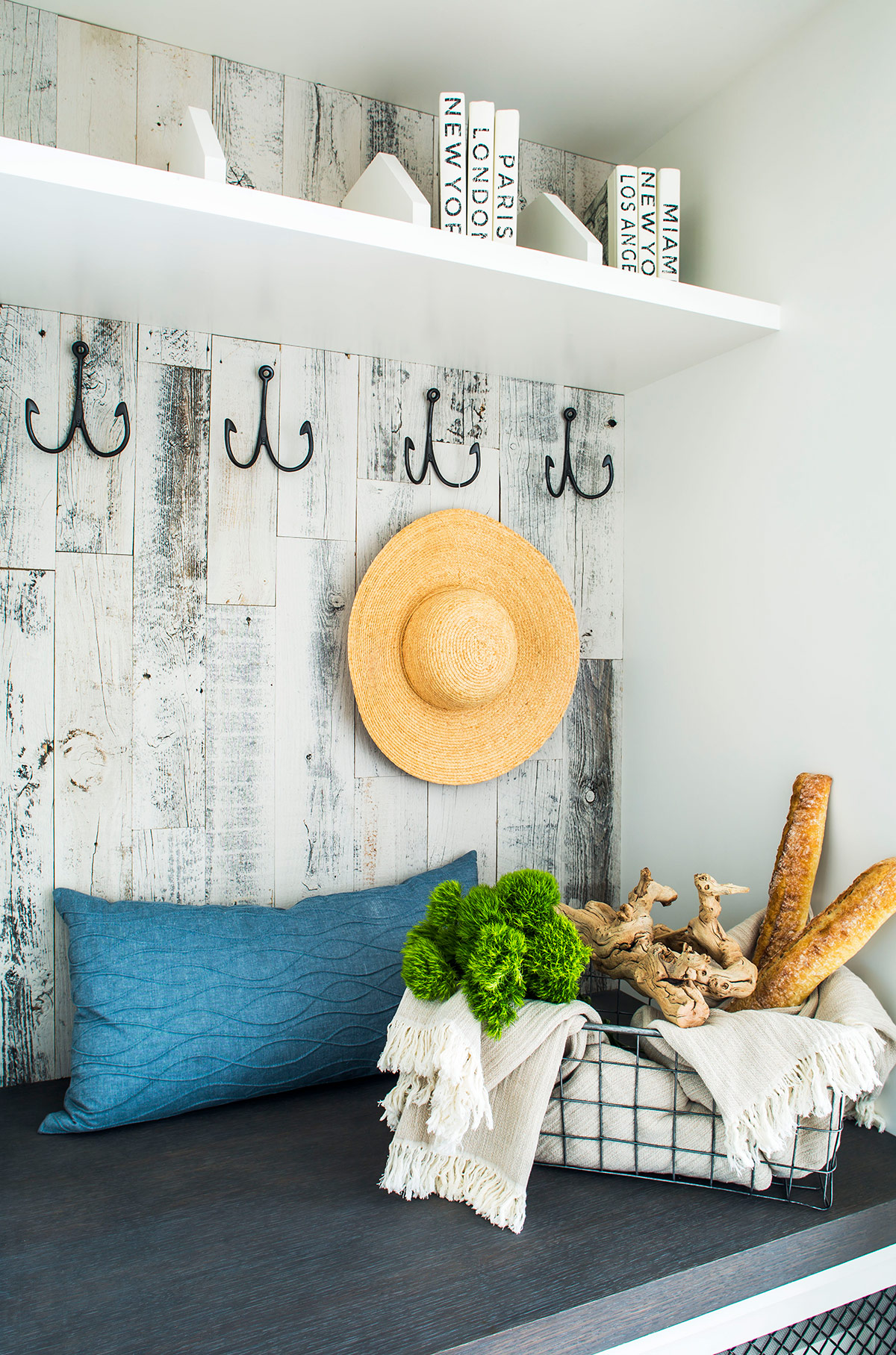 Coastal inspired mudroom with wood paneling