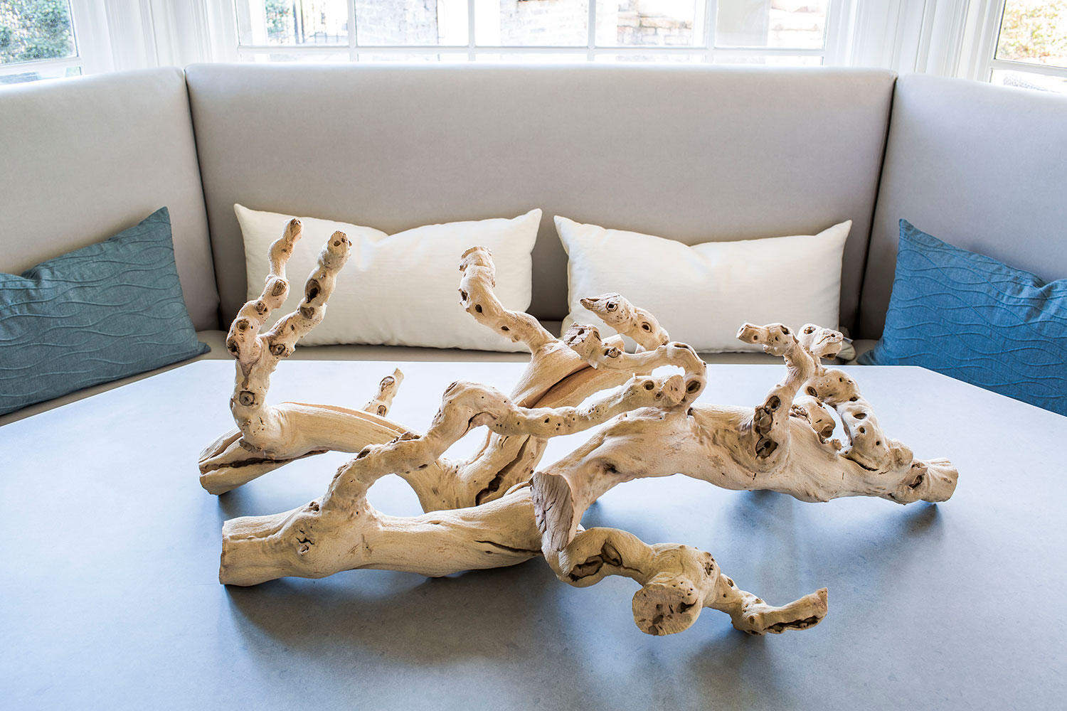 Driftwood accessorizes the breakfast nook table