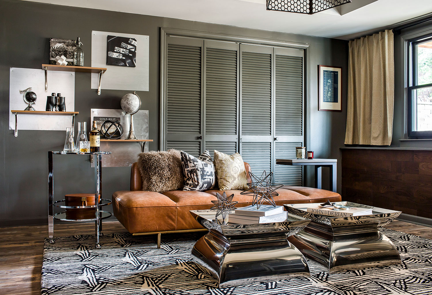 Sitting area with caramel leather chaise in basement office