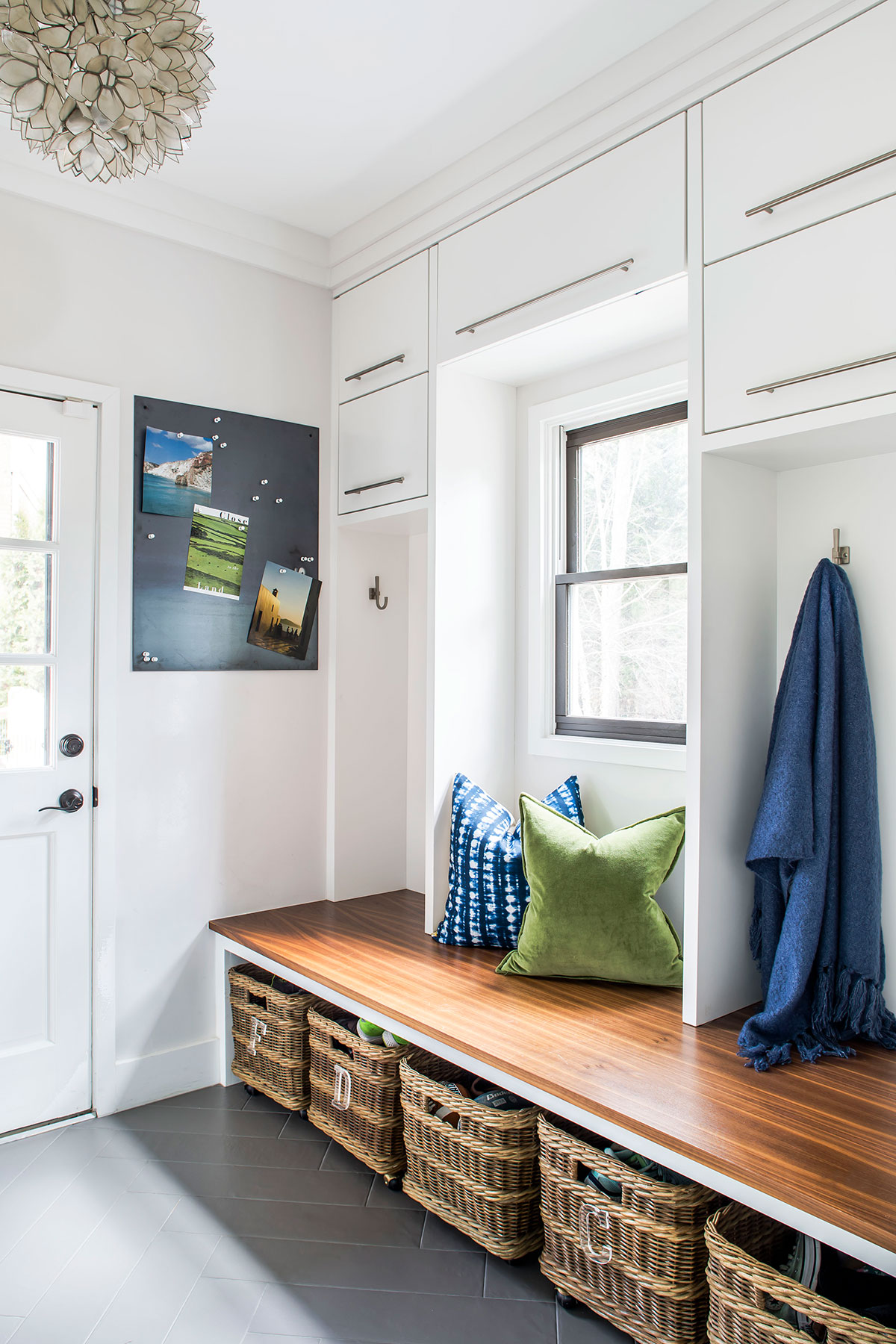 Contemporary mudroom with wood bench and under bench storage baskets