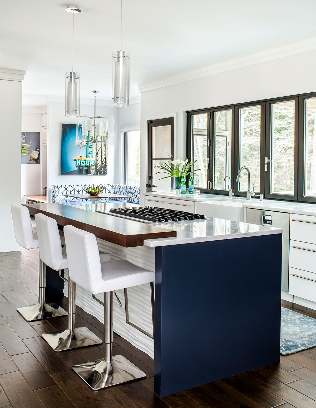 Contemporary kitchen island with gas range and wood counter