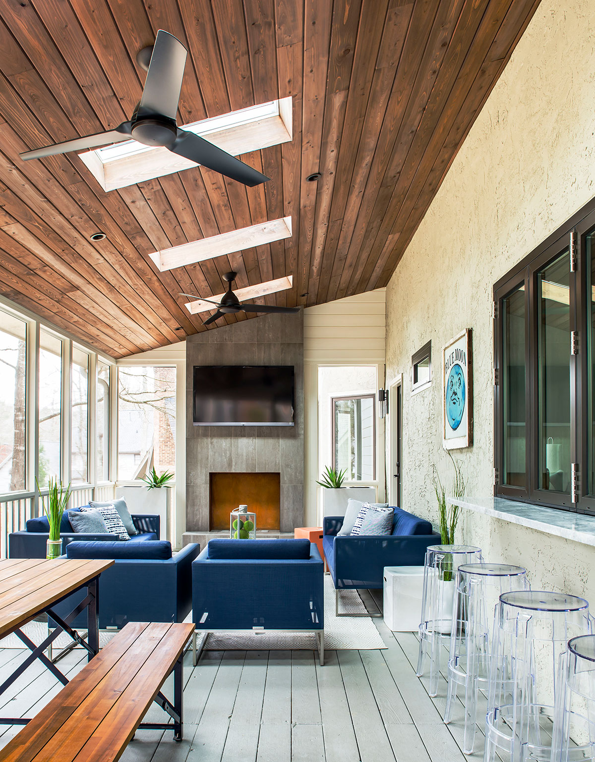 Screened-in porch with skylights and contemporary furniture