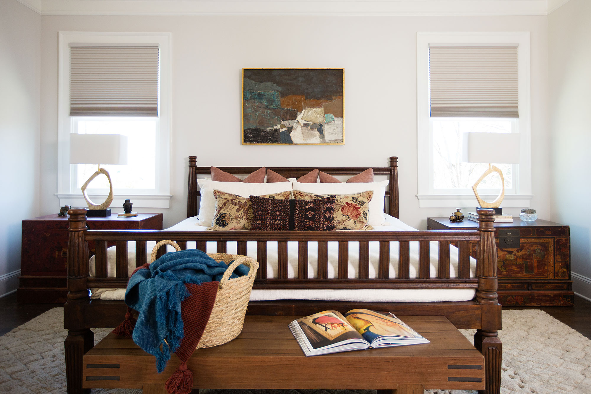 Master bedroom featuring antique and globally sourced furniture