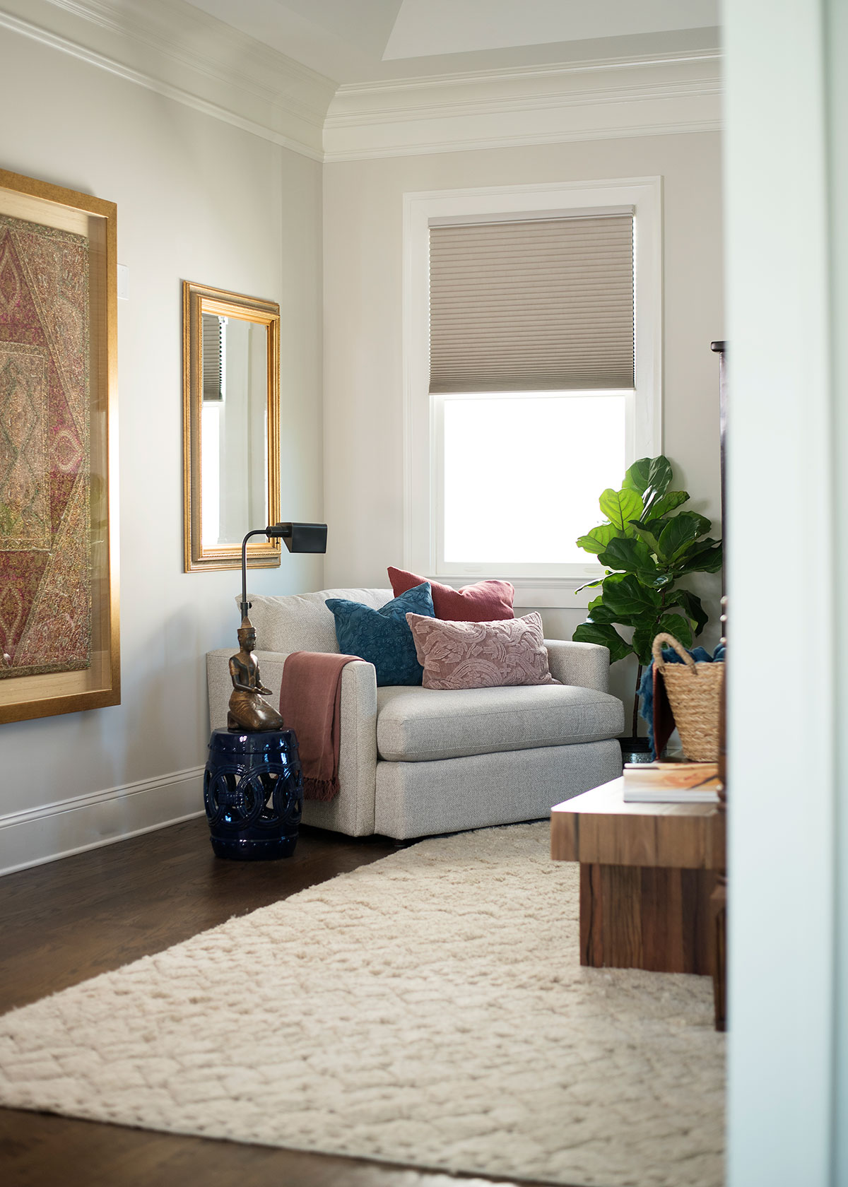 Sitting area in master bedroom with wood and brass accents