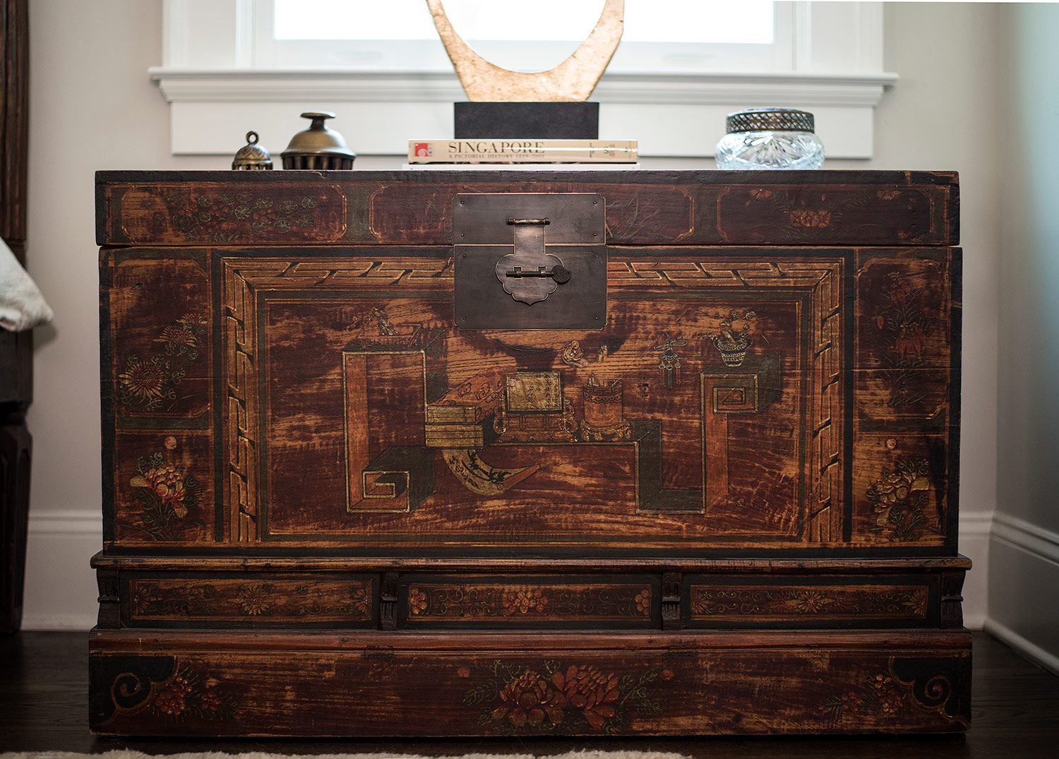 Antique Chinese trunk used as a night stand in master bedroom