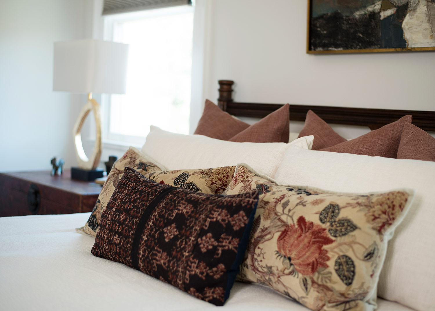 Floral throw pillows on bed in master bedroom