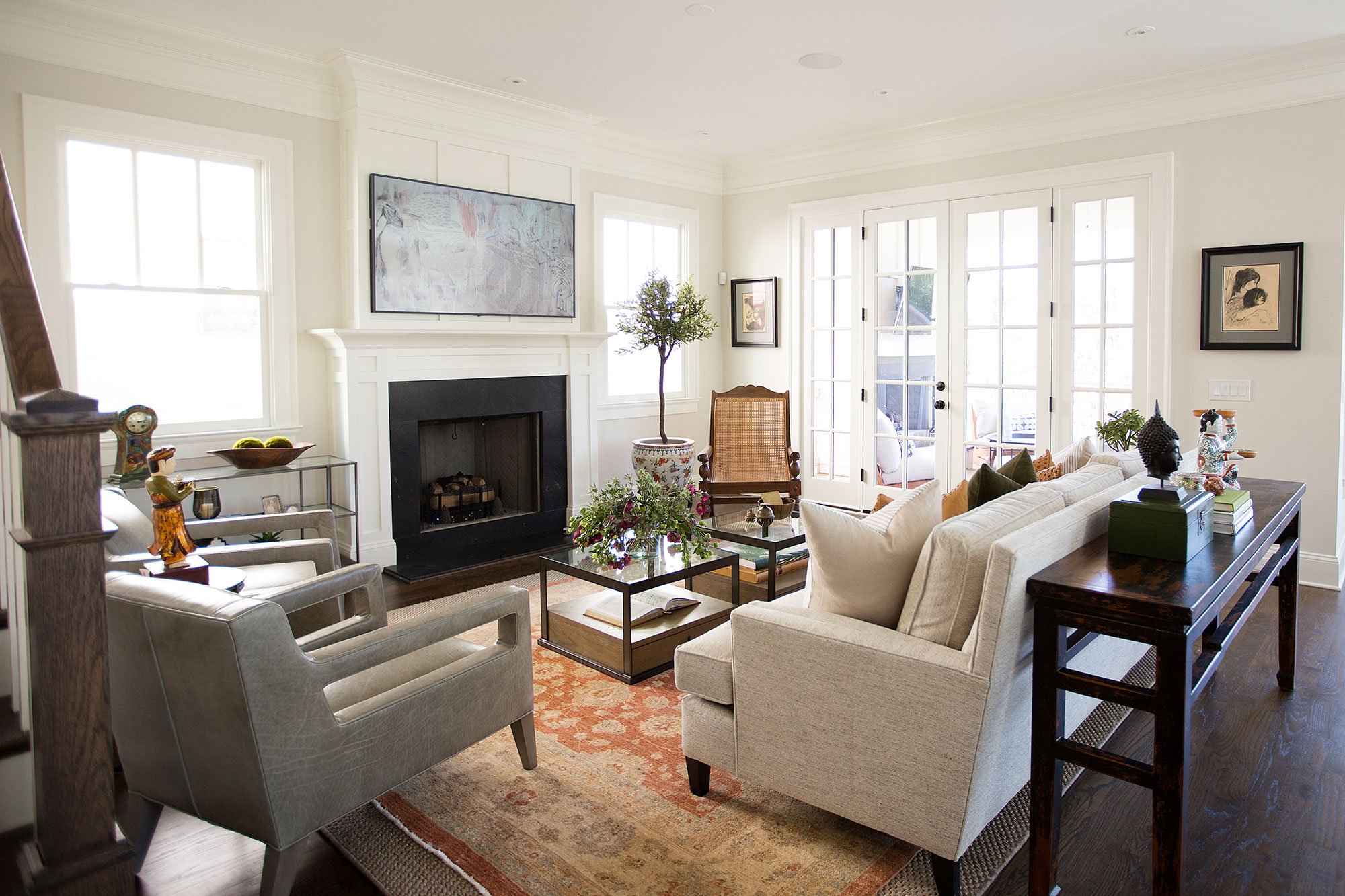 Transitional living room with beige sofa, chairs, and orange area rug
