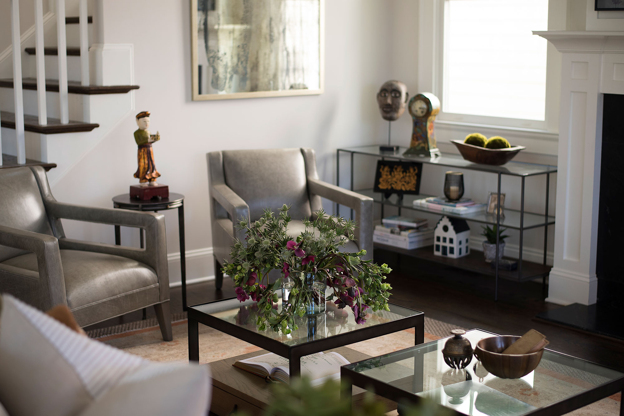 Leather chairs and glass shelving unit for displaying accessories
