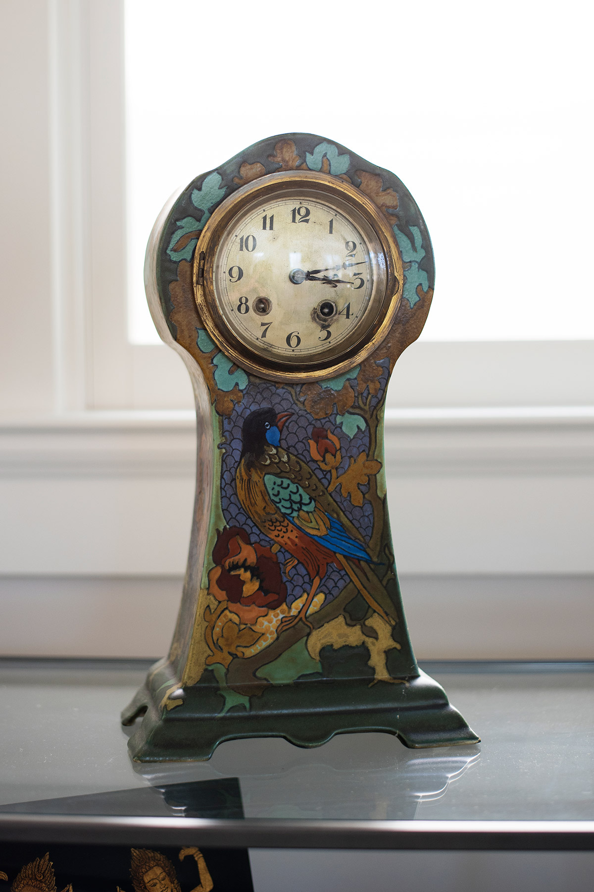 Antique painted clock with image of bird