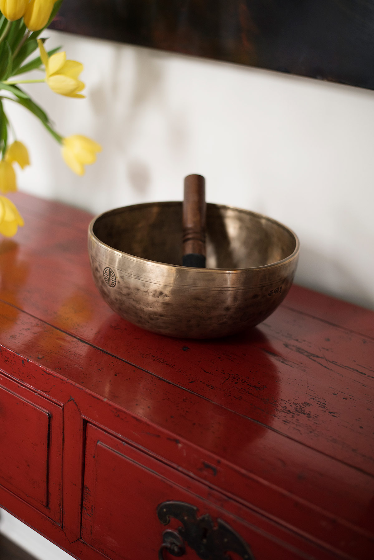 Antique red console table, with Tibetan singing bowl