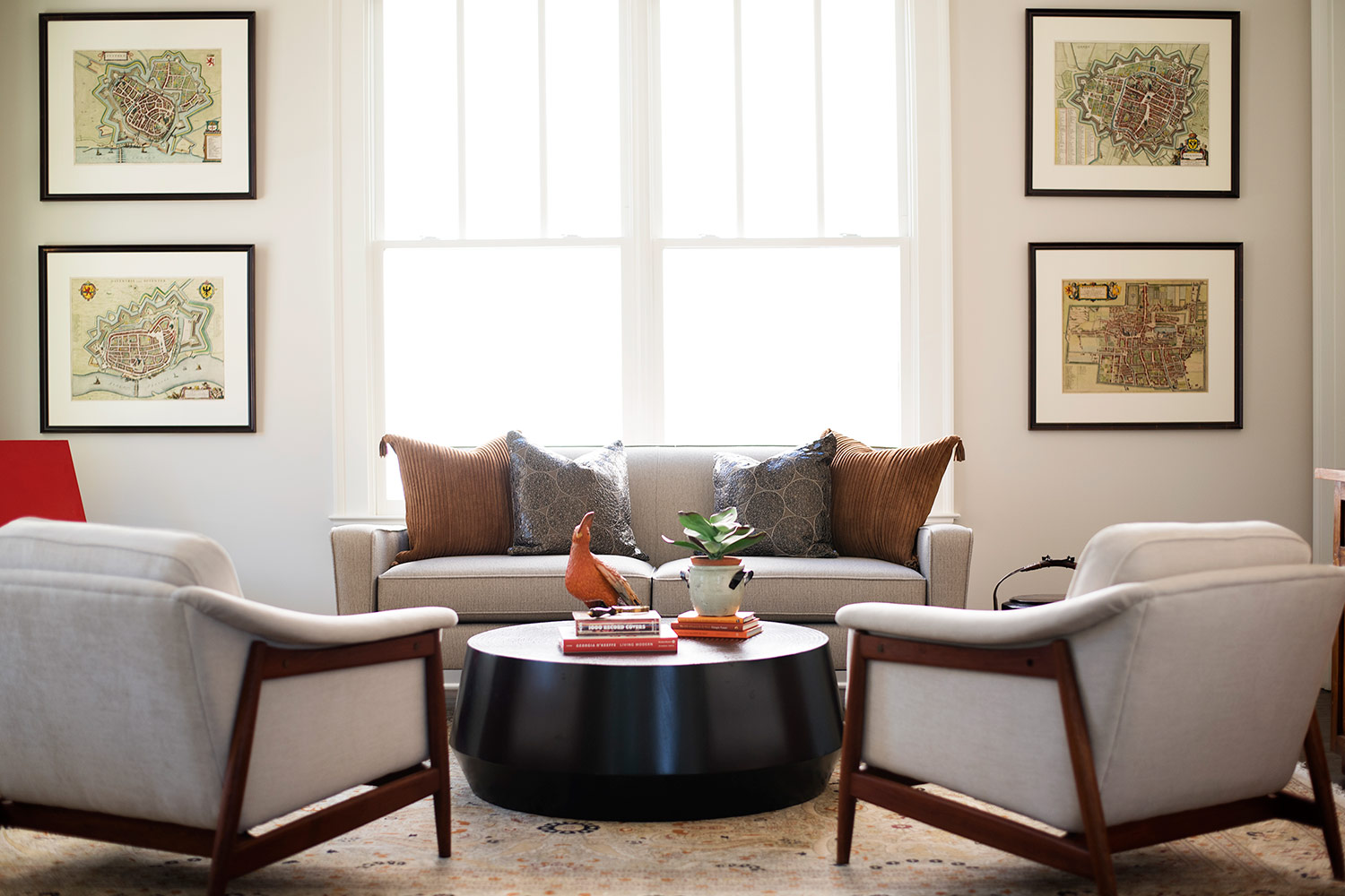 Transitional sitting room with beige furniture and round wood coffee table