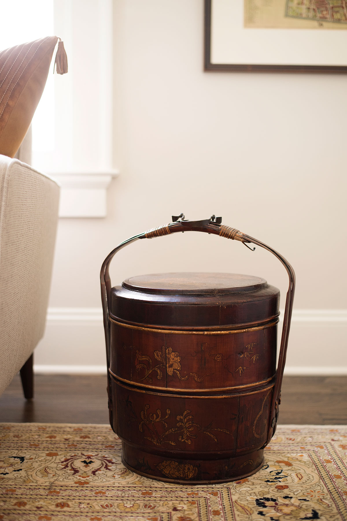 East Asian antique bucket used as side table