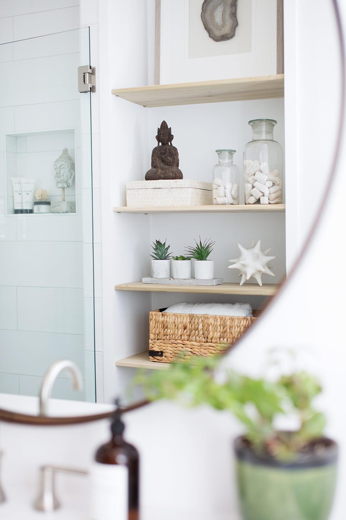 Built in floor to ceiling shelves in guest bathroom