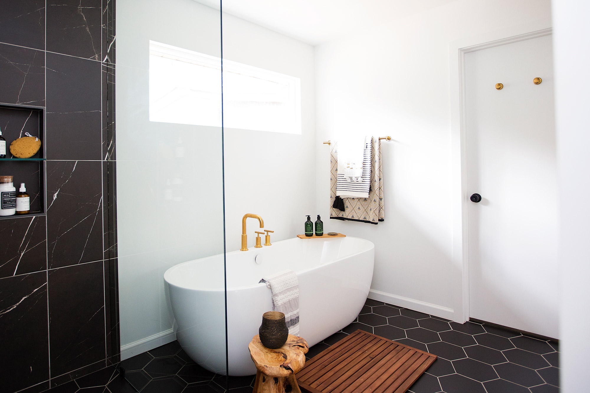 Midcentury modern master bathroom with freestanding tub and walk-in shower